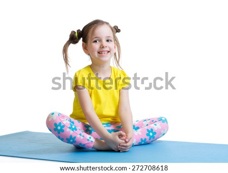 child girl does gymnastics sitting in butterfly pose isolated on white - stock photo