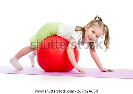 child girl doing gymnastic exercises with fitness ball