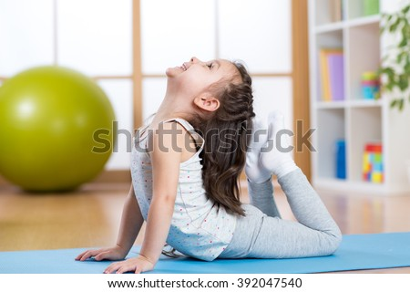 Child girl doing gymnastics - stock photo