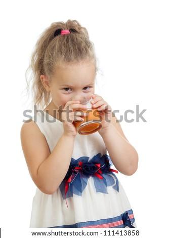 child girl drinking juice isolated on white background - stock photo