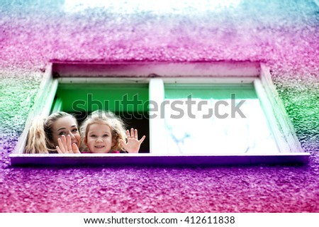 Child girl five years old drinking water from glass under the supervision of a beautiful young woman - stock photo