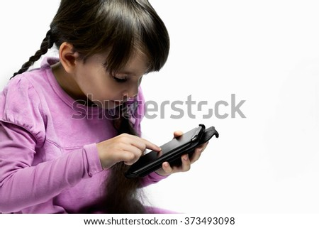 child girl happy look smart phone. Bad habits, the dependence of the child. - stock photo