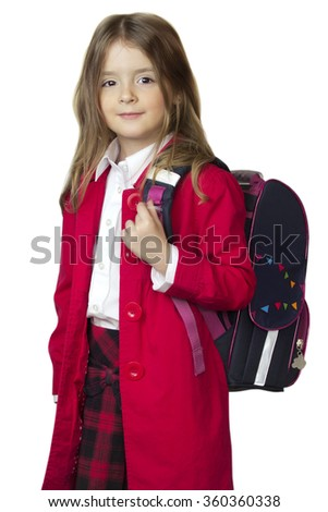 Child girl in school uniform with bag backpack isolated on white. Pupil smiling caucasian. - stock photo