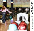 Child girl in with bowling ball learn game. - stock photo