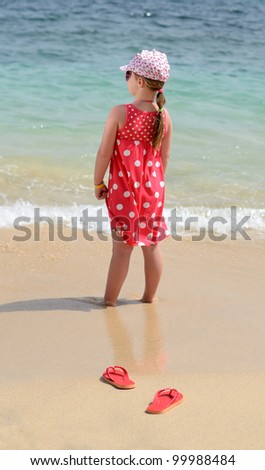 Child girl on tropical beach - stock photo