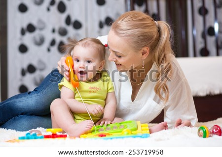 child girl phone with mother playing with toy phone