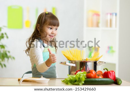 child girl playing cook and preparing healthy food - stock photo