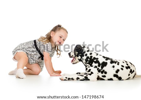 child girl playing puppy dog - stock photo