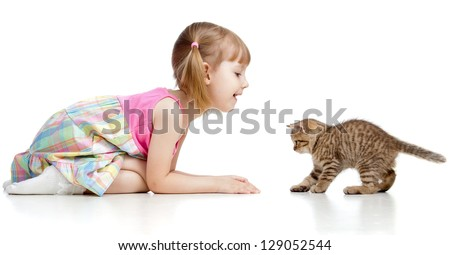 child girl playing with cat kitten - stock photo