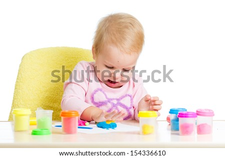 child girl playing with clay toy - stock photo