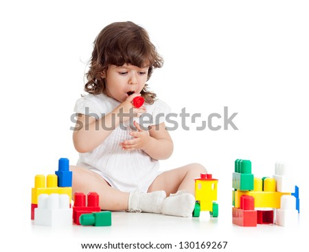 child girl playing with construction set