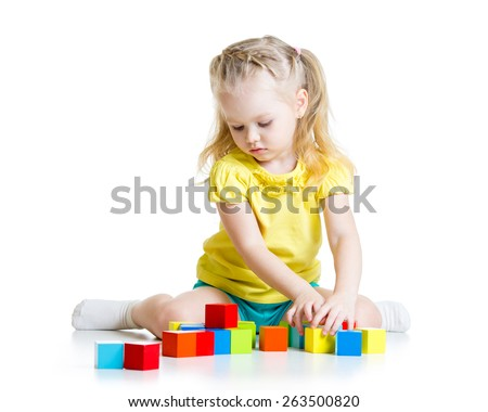 child girl playing  wooden cubes isolated on white