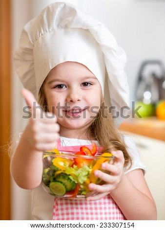 child girl preparing healthy food and showing thumb up