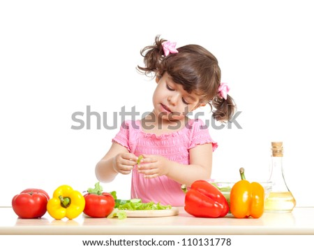 Child girl preparing vegetables for salad. Concept of healthy food.