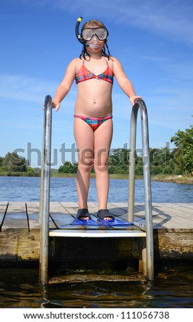 Child girl ready to dive - stock photo