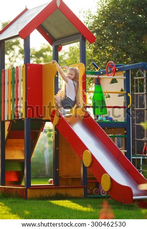 child girl riding on the hill - stock photo