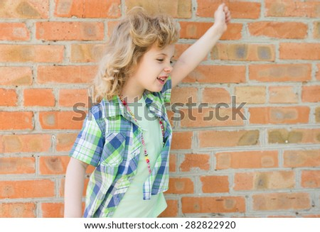 Child girl screaming with happy expression hand up - stock photo
