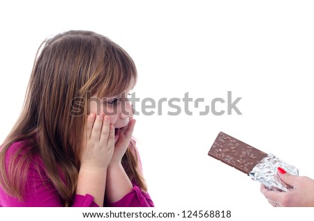 Child girl surprised because of whole chocolate gift - stock photo