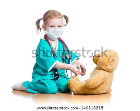 child girl with clothes of doctor playing toy - stock photo