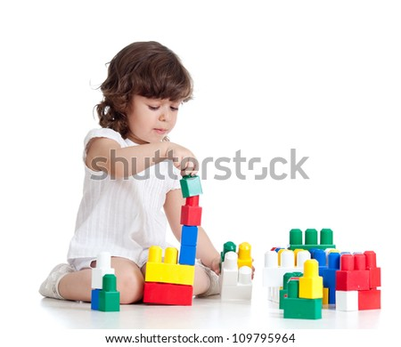 child girl with construction set over white background