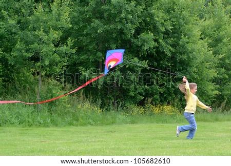 Child girl with kite - stock photo
