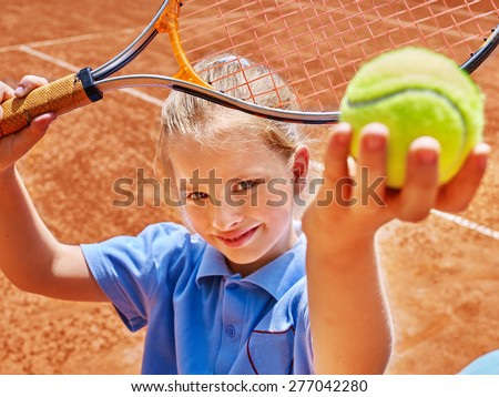 Child girl with racket and ball on  tennis court.  - stock photo