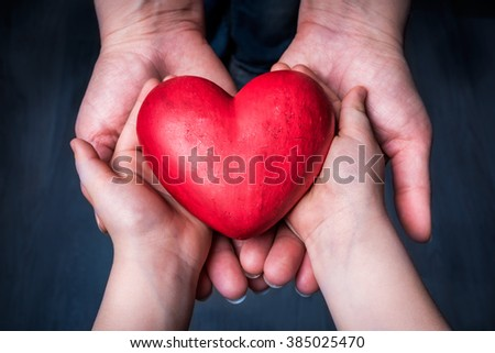 Child Gives Red Hart To Woman - Mother Day - stock photo