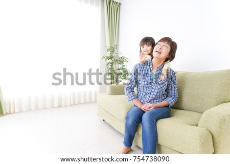 Child giving grandmother a massage