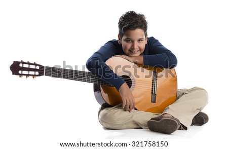 Child guitarist looking at the camera isolated on white background.