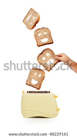 Child hand catches toast bread slices flying out of a toaster - isolated - stock photo