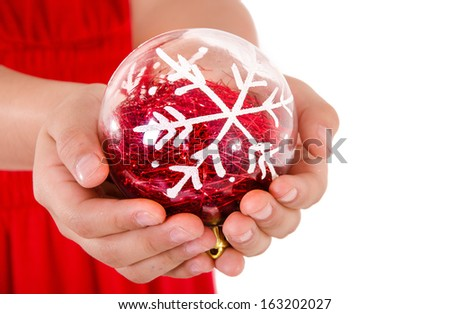 Child Hand holding a christmass ornament