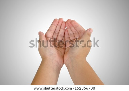 child hand holding isolated on white - stock photo