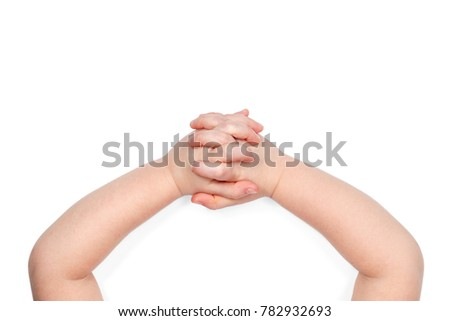 Child hands folded in the lock, top view, isolated on white background