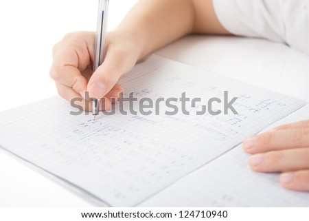 Child hands writing a homework by closeup - stock photo
