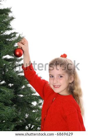 Child hanging ornament smile copyspace - stock photo