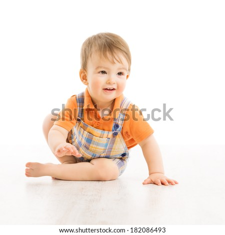 Child happy smiling, small one year boy crawling over white background