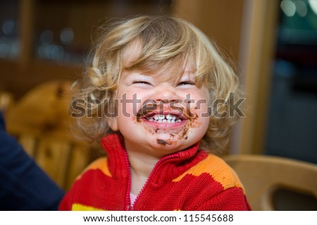 child has a sweet breakfast - stock photo