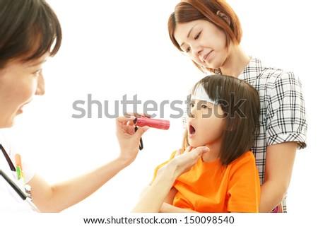 Child having physical examination - stock photo