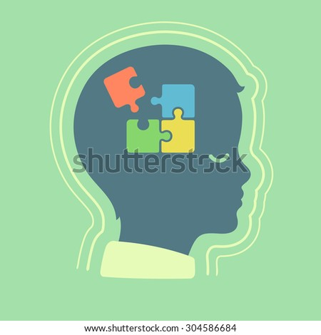 child head silhouette with jigsaw puzzle symbolizing autism spectrum disorders - stock photo
