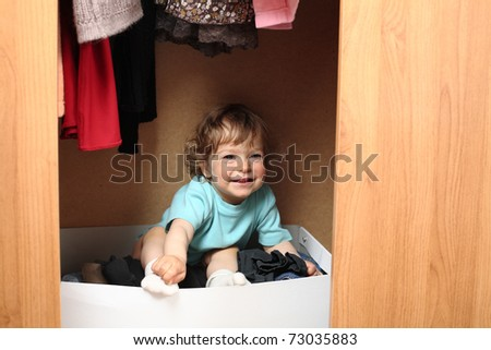 Child hiding in wardrobe