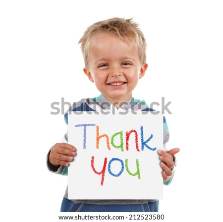 Child holding a crayon thank you sign standing against white background - stock photo