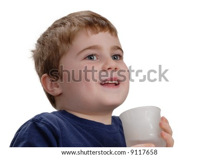 Child holding a glass of water, isolated on white - stock photo