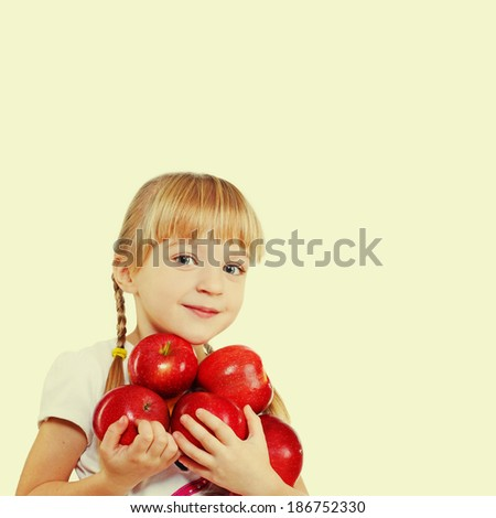 child holding a lot of red apples - stock photo