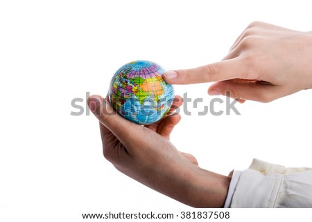 Child holding a small globe in hand on white background