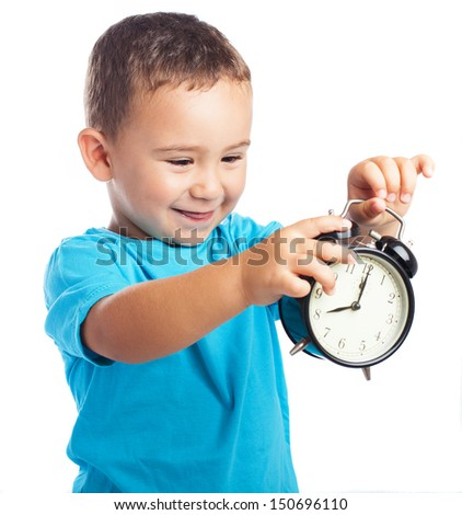 child holding an alarm clock on a white background - stock photo
