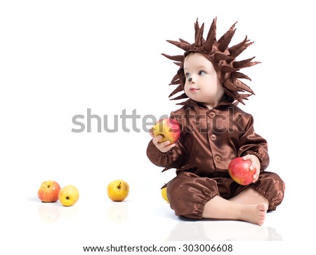 child holding an apple in his hands and wearing a suit hedgehog. studio shot - stock photo