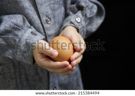 child holding an egg, care, gentle