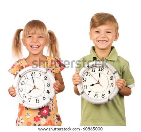 Child holding big clock isolated on white background - stock photo