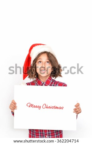 Child holding Christmas card in hand. Isolated on white background - stock photo