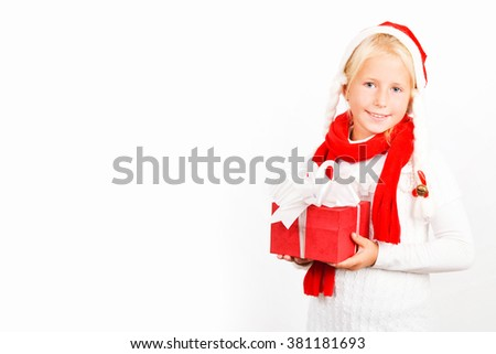 Child holding Christmas gift box in hand. Isolated on white background